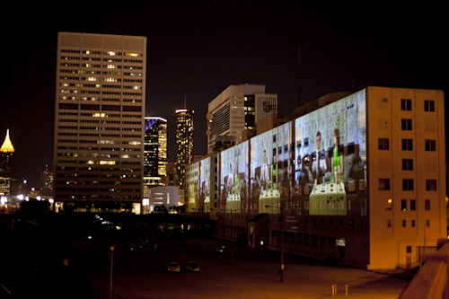 Atlanta building with video projected on the side