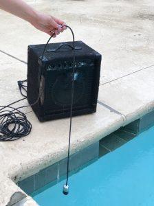 Image of speaker next to pool