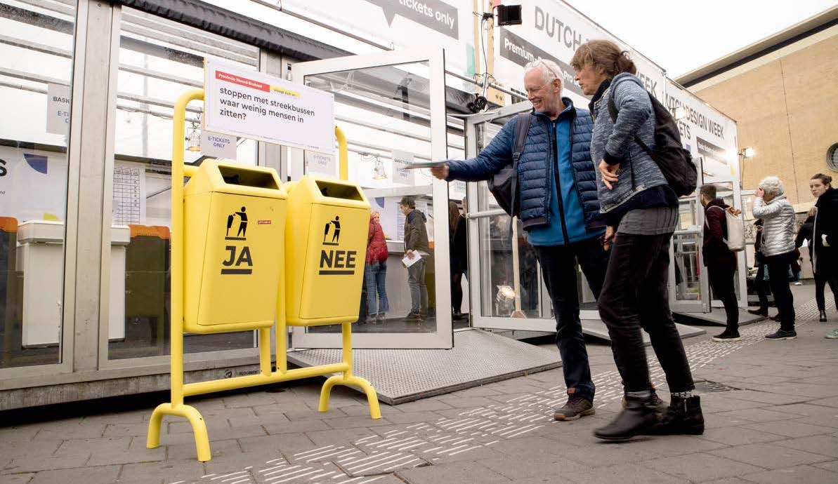 Image of two people engaging with the project during Dutch Design Week 2018